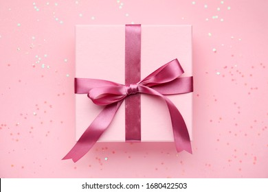 Beautiful gift on color background