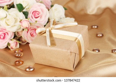 Beautiful gift on flowers background