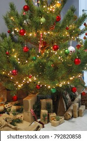 Beautiful gifts lie under the New Year tree.