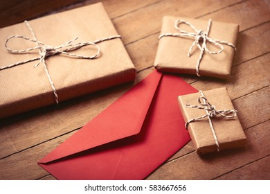 beautiful gifts and red envelope lying on the wonderful brown wooden background