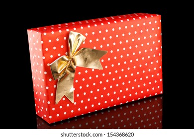 Beautiful gifts in wrapping paper of red color on a black background.