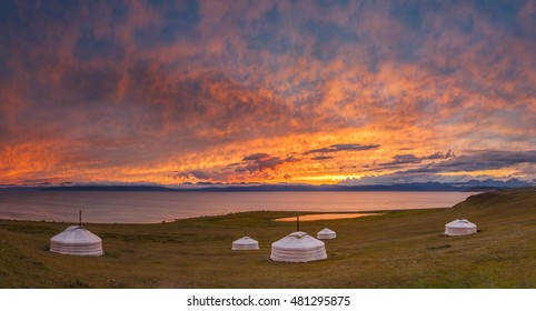 Beautiful ginger sunset on the Hovsogol lake with traditional mongolian yurts