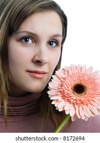 Beautiful girl with african daisy on white background