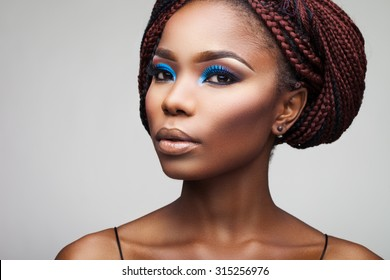 beautiful girl with African roots on a white background