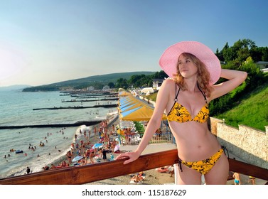 The beautiful girl against the Black Sea beach. Divnomorsky. Russia