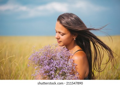 beautiful girl against yellow field and blue sky. ukraine flag