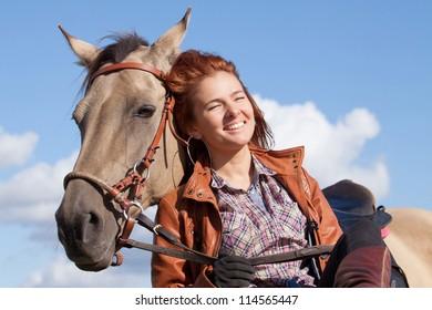 Beautiful girl and Akhal-Teke horse outdoors