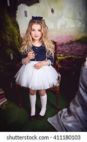 Beautiful girl as Alice in Wonderland