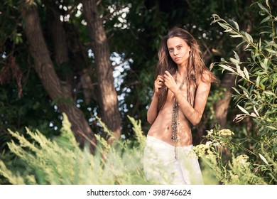 beautiful girl among the trees on a deserted island