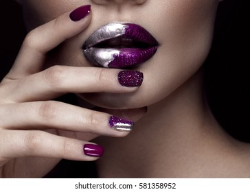 Beautiful girl with art make-up, dark glitter lips design and manicure nails. beauty face. Photos shot in studio. Close up