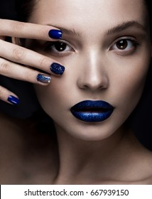 Beautiful girl with art make-up, dark glitter lips design and manicured nails. beauty face. Photos shot in studio