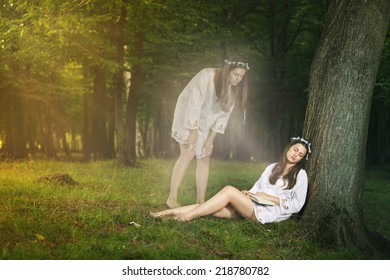Beautiful girl in astral projection looks herself sleeping . Mystical and weird concept