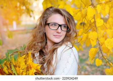 beautiful girl in the autumn of glasses for vision