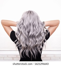 beautiful girl back with grey silver ash blonde wavy hair isolated