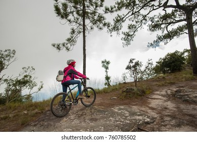 Beautiful girl with backpack Get ready for a mountain bike ride.