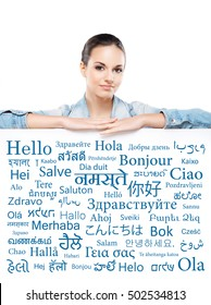 Beautiful girl with a banner of world's different languages over grey background.