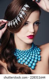 beautiful girl beauty studio portrait on dark blue background