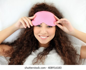 Beautiful girl in bed with eye mask