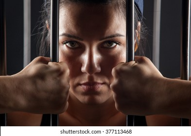beautiful girl behind bars in jail