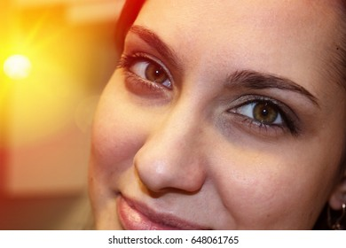 A beautiful girl with big green eyes and puffy succulent lips. The capricious lady is playful and seductive. Face of beauty close-up. Sweetheart with a cunning fox-like cut of a person