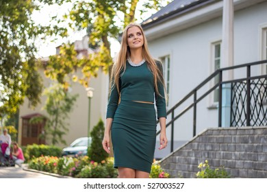 Beautiful girl with a big smile in summer park. Business style