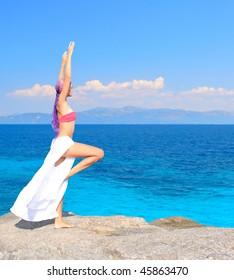 a beautiful girl in bikini on the beach in Greece