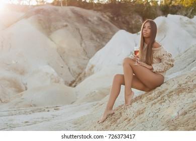 Beautiful girl in a bikini on the beach.