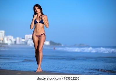 Beautiful girl in bikini on Leblon beach in Rio de Janeiro, Brazil