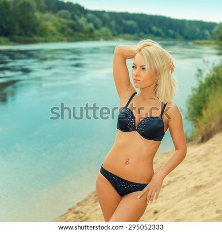 c576cc0201b88 beautiful girl in a black bikini on the beach. Outdoor portrait of tanned girl  having fun on sun - Image