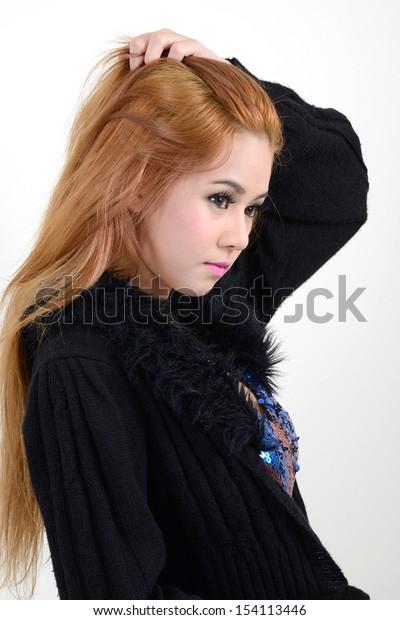 Beautiful girl in black coat on white background.