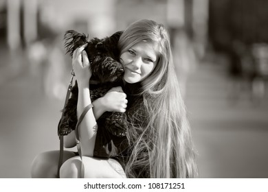 beautiful girl with a black dog