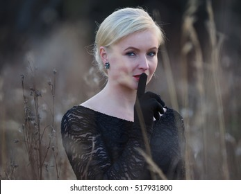beautiful girl in a black dress. forest