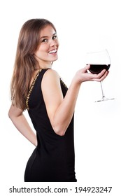 Beautiful girl in black dress holding a glass of red wine