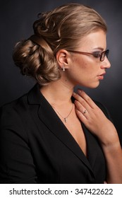 beautiful girl in black jacket and glasses