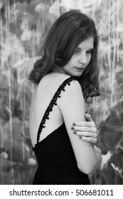 beautiful girl with blond curly hair in a beautiful long black lace dress, black & white photos