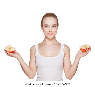 The beautiful girl the blonde holds apple halves
