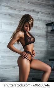 1f4b327da7d Beautiful girl blonde in lingerie posing in the morning in a bright room