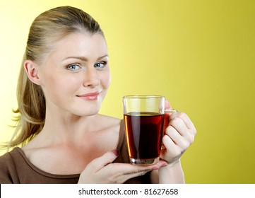 beautiful girl the blonde with a tea mug in hands