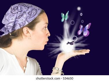 Beautiful girl blowing butterflies - future reader