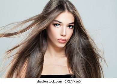 Beautiful Girl with Blowing Hair. Young Woman Fashion Model with Long Healthy Hairstyle, Beauty Salon Background