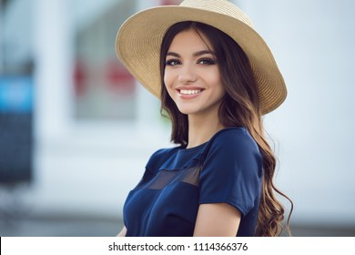 beautiful girl in blue dress on the street. summer portrait