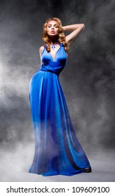 Beautiful girl in blue evening dress