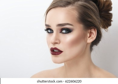 Beautiful girl with blue eyes bright make-up and hairstyle