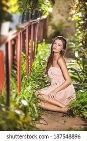 beautiful girl in botanic garden