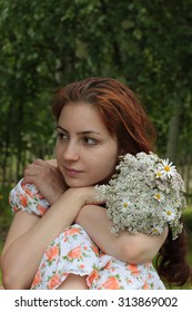 beautiful girl with a bouquet in sandals