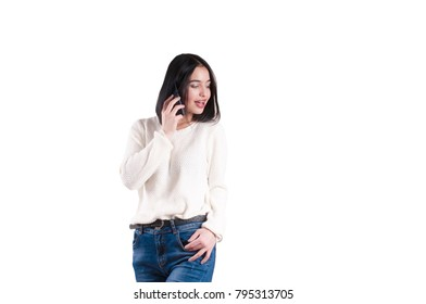 beautiful girl braces sweater jeans with phone isolated