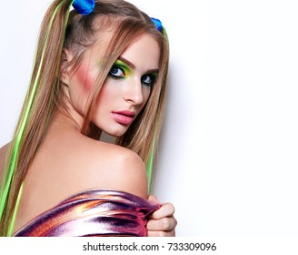 Beautiful girl with bright make-up and colored hair.Harley Quinn.Colored hair, makeup, hair, tails, cosmetics, beauty salon.