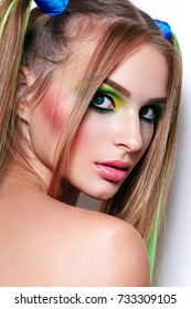 Beautiful girl with bright make-up and colored hair.