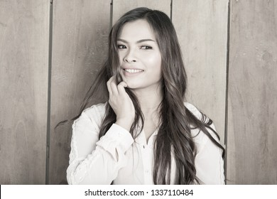 Beautiful girl with bright style and woman eyes. on wood background