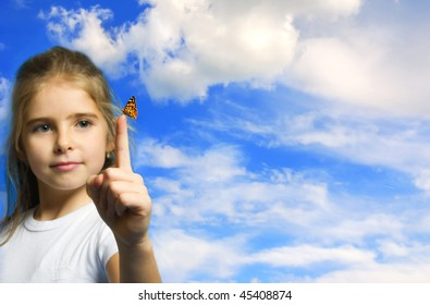a beautiful girl with butterfly over cloudy sky